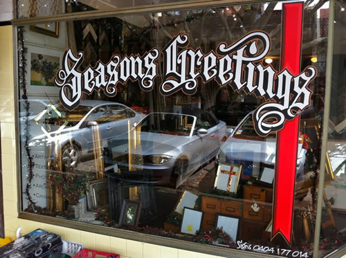 hand painted window sign